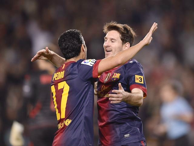 Lionel Messi celebrates after scoring against Zaragoza on November 17, 2012