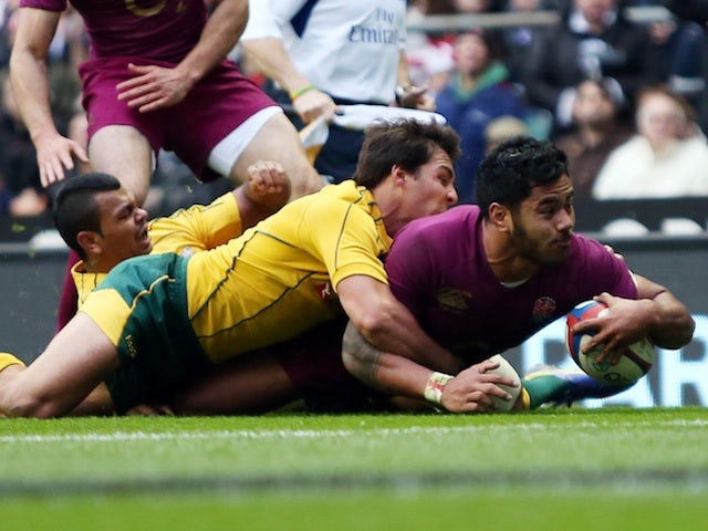 England's Manu Tulagi slides in a try against Australia on November 17, 2012