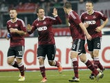 Markus Feuiner celebrates with team-mates after scoring for Nuremberg on November 17, 2012