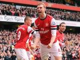 Per Mertesacker celebrates scoring Arsenal's first on November 17, 2012
