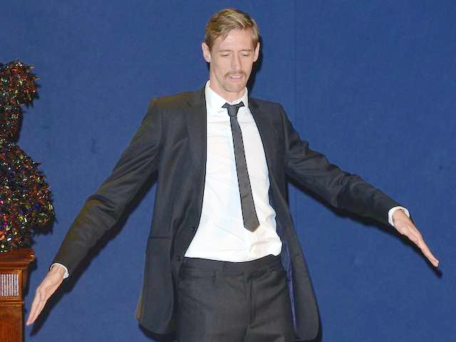 Peter Crouch sports a tache and dances on stage at the launch of the Designer Pudsey 2012 Collection