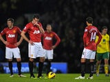 Robin van Persie and Javier Hernandez stand miserable after Norwich go ahead on November 17, 2012