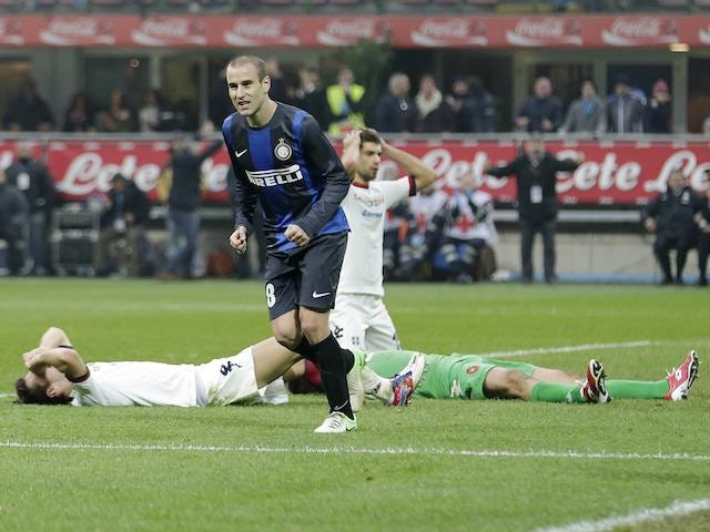 Inter's Rodrigo Palacio cheers after Cagliari's Davide Astori scores an own goal on November 18, 2012