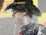 Sebastian Vettel sprays himself in the face after the US Grand Prix on November 18, 2012