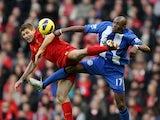 Steven Gerrard and Emmerson Boyce lock legs on November 17, 2012