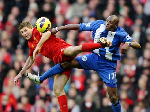 Steven Gerrard and Emmerson Boyce lock legs on November 17, 2012