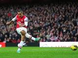 Theo Walcott scores for Arsenal on November 17, 2012