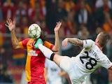 Man Utd's Alex Buttner challenges Hamit Altintop on November 20, 2012