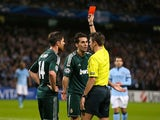 Alvaro Arbeloa is shown a red card on November 21, 2012
