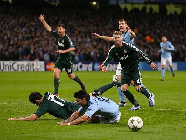 Alvaro Arbeloa brings down Sergio Aguero in the penalty area on November 21, 2012