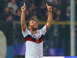 Genoa's Andrea Bertolacci celebrates moments after scoring the opener on November 25, 2012