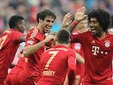 Franck Ribery celebrates his goal with teammates on November 24, 2012