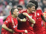 Javi Martinez celebrates scoring the opening goal with teammates on November 24, 2012