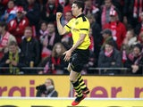 Robert Lewandowski celebrates scoring his goal on November 24, 2012