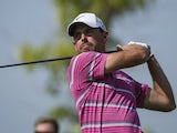 Charl Schwartzel tees off during the final round of the World Tour Championship in Dubai on November 25, 2012