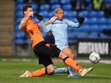 Coventry City's David McGoldrick and Portsmouth's L'ubomir Michalik battle for the ball on November 24, 2012