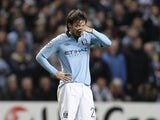 An upset David Silva holds his hand to his face after the final whistle on November 21, 2012