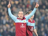 Burnley's Dean Marney celebrates his opener against Hull City on November 24, 2012