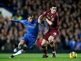 Gareth Barry holds back Eden Hazard as they battle for the ball on November 25, 2012