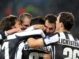 Fabio Quagliarella is mobbed by team-mates after scoring versus Chelsea on November 20, 2012