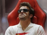 Fernando Alonso sits in his team's pit on November 23, 2012