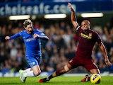 Fernando Torres and Vincent Kompany battle for the ball on November 25, 2012