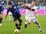 Genoa's Juraj Kucka and Atalanta's Giacomo Bonaventura battle for the ball on November 25, 2012
