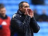 Portsmouth's caretaker manager Guy Whittingham instructs his team on November 24, 2012