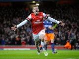 Jack Wilshere celebrates scoring for Arsenal on November 21, 2012