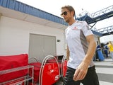 Practice leader Jenson Button walks into the pitlane in Brazil on November 24, 2012