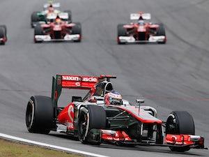 Button wins in Brazil, Vettel is world champion