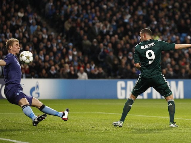 Karim Benzema scores the opener for Real Madrid past Joe Hart on November 21, 2012