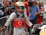 Lewis Hamilton celebrates moments after clocking the fastest qualifying time to secure pole position at Interlagos on November 24, 2012