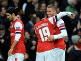 Lukas Podolski celebrates scoring a pretty-special-too goal for Arsenal on November 21, 2012