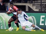 Anderlecht's Massimo Bruno and AC Milan's Kevin Constant clash on November 21, 2012