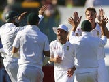 South Africa's Morne Morkel celebrates with team-mates on November 24, 2012