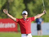 Rory McIlroy celebrates moments after finishing his final shot to win the World Tour Championship in Dubai on November 25, 2012