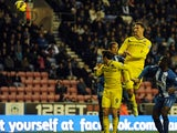 Reading's Sean Morrison heads the opener against Wigan on November 24, 2012