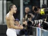Juventus' Sebastian Giovinco celebrates his team's third goal versus Chelsea on November 20, 2012