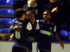 Southend United's Britt Assombalonga celebrates his goal with teammates on November 24, 2012