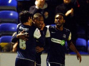 Southend United's Britt Assombalonga celebrates his goal with teammates on November 24, 2012