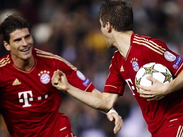 Thomas Muller and Mario Gomez celebrate Bayern's equaliser on November 20, 2012