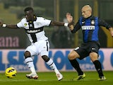 Parma's Afriye Acquah and Inter's Esteban Cambiasso fight for possession on November 26, 2012