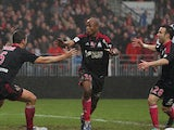 Marseille's Andre Ayew celebrates with team mates after scoring the winner on December 2, 2012