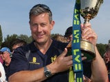 Ashley Giles standing proudly with his trophy on September 6, 2012
