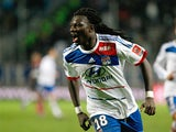 Bafetimbi Gomis celebrates after completing his hat-trick against Marseille on November 28, 2012