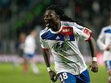 Bafetimbi Gomis celebrates after completing his hat-trick against Marseille on November 28, 2012