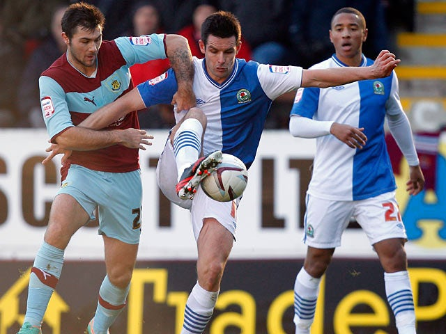 Burnley's Charlie Austin and Blackburn's Scott Dann battle for the ball on December 2, 2012