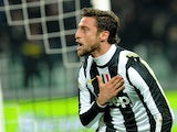 Juventus' Claudio Marchisio celebrates scoring his team's opening goal against Torino on December 1, 2012