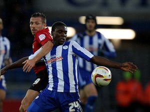 Cardiff's Craig Bellamy and Sheffield Wednesday's Jeremy Helan battle for the ball on December 2, 2012